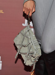 Tyra's soft gray suede clutch added another layer of texture to her gray ensemble.