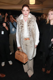 Debra Messing complemented her exotic fashion week look with a beige snakeskin tote.