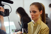 Model Coco Rocha is interviewed backstage at the Michael Kors Fall 2012 fashion show during Mercedes-Benz Fashion Week at The Theatre at Lincoln Center on February 15, 2012 in New York City.
