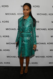Jada Pinkett Smith's snakeskin trench mixed traditional with quirky with its bright teal color and over sized belt.