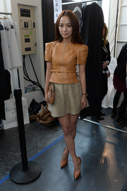 Wang Luodan donned and edgy-chic camel-colored zip-up leather top for the Michael Kors fashion show.