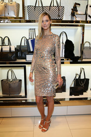Carmen Kass stole the show in a metallic silver and nude cocktail dress by Michael Kors during the designer's Milano cocktail party.