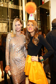 A chunky cuff bracelet added more color and flair to Anna dello Russo's bright frock during the Michael Kors Milano cocktail party.