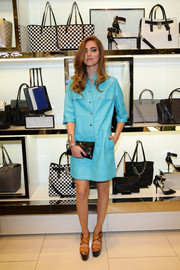 Chiara Ferragni looked downright smart and stylish in a turquoise shirtdress during the Michael Kors Milano cocktail party.