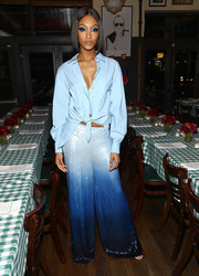 Jourdan Dunn jazzed up her shirt with a pair of ombre palazzo pants.