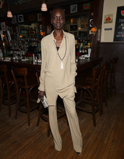 Alek Wek looked simply stylish in a khaki button-down at the Michael Kors and David Downton collaboration dinner.