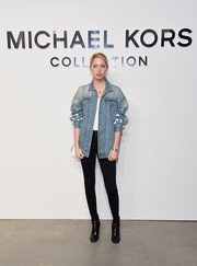 Princess Maria-Olympia of Greece and Denmark kept it casual in a denim jacket at the Michael Kors Fall 2017 show.