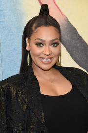 La La Anthony attended the Michael Kors fashion show sporting a partially braided, half-up 'do.
