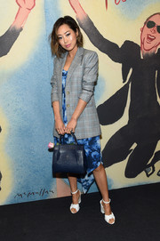Aimee Song styled her look with a chic navy crocodile tote.