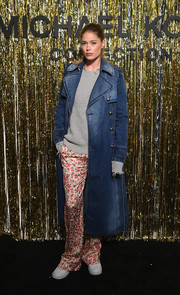 Doutzen Kroes was tough-chic in a denim trenchcoat by Michael Kors during the brand's Fall 2019 show.