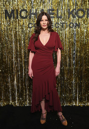 Catherine Zeta-Jones styled her frock with a pair of studded T-strap pumps.