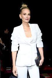 Molly Sims teamed a black box clutch with a white suit for the Michael Kors Fall 2019 show.