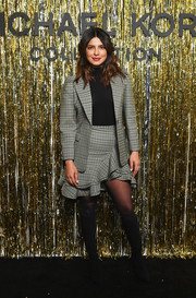 Priyanka Chopra suited up in this gray glen plaid jacket and mini skirt combo by Michael Kors for the brand's Fall 2019 show.