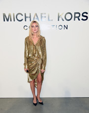 Chiara Ferragni shone in a loose gold button-down by Michael Kors during the brand's fashion show.