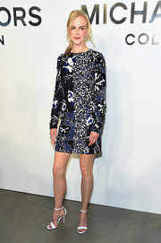 Nicole Kidman injected a bright spot with a pair of white ankle-strap sandals, also by Michael Kors.