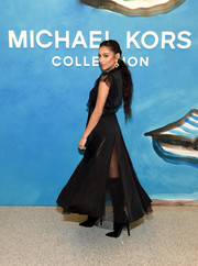 Shay Mitchell teamed black knee-high boots with a maxi dress for the Michael Kors Spring 2019 show.