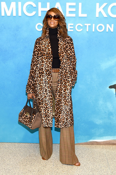 Iman took matchy-matchy to the extreme. Her leopard and plaid tote was an exact copy of her coat and trousers!