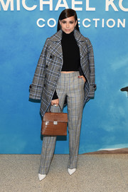 Sofia Carson was fall-chic in a plaid pea coat by Michael Kors during the brand's Spring 2019 show.