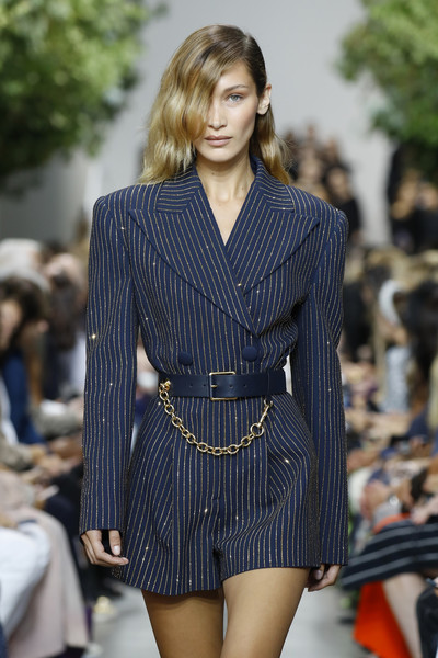 Bella Hadid wore a navy leather belt with a gold chain accent at the Michael Kors Spring 2020 show.