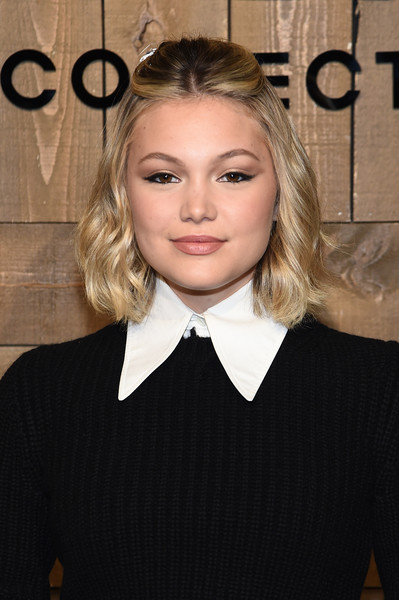 Olivia Holt sported a cute half updo at the Michael Kors Fall 2020 show.