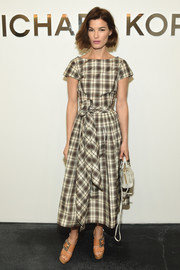Hanneli Mustaparta was breezy-chic at the Michael Kors fashion show in a belted plaid dress from the brand.