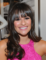 To recreate Lea Michele's fun and flattering look, begin by curling three-inch sections of hair only from the ears down. Keep lash-length bangs straight. To finish the look, tousle curls with fingertips and mist with a product like Carol's Daughter Tui Moisturizing Hair Sheen to de-frizz and add incredible shine.