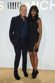 Naomi Campbell teamed her dress with black lace open-toe booties.
