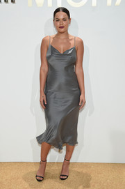 Atlanta de Cadenet Taylor put on a curvy display in a slinky gray slip dress by Michael Kors during the brand's fragrance launch.