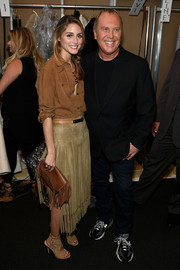 Olivia Palermo was cowgirl-chic in a brown suede button-down during the Michael Kors fashion show.