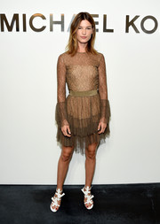 Hanneli Mustaparta went for a flirty vibe at the Michael Kors fashion show in a sheer lace dress with a tiered skirt.
