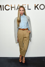 Harley Viera-Newton attended the Michael Kors fashion show wearing a buttoned-all-the-way-up shirt.