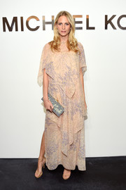 Poppy Delevingne was boho-glam in a tiered nude Michael Kors maxi dress during the label's fashion show.