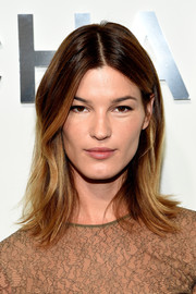 Hanneli Mustaparta sported a hip center-parted hairstyle with flippy ends during the Michael Kors fashion show.