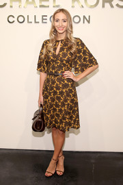 Harley Viera-Newton kept it demure in a Michael Kors print dress with flutter sleeves during the label's fashion show.