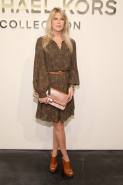 Alexandra Richards attended the Michael Kors fashion show looking boho in a long-sleeve print dress.