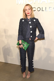 Emily Blunt pulled together a tailored and preppy look that feature a frilled denim jacket with polka-dot sleeves, a matching blouse, and buttoned trousers at the Michael Kors Spring 2017 show.