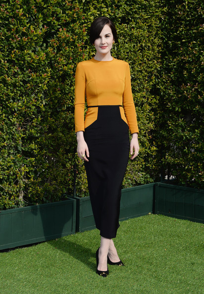 Michelle Dockery Evening Pumps [clothing,green,dress,yellow,fashion,crop top,shoulder,pencil skirt,neck,formal wear,lovegold honors,michelle dockery for a celebration of gold,michelle dockery,gold,california,los angeles,chateau marmont,glamour,celebration]