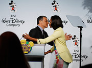 A beige blazer added a neutral touch to Michelle Obama's colorful dress when she attended a Disney news conference.