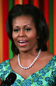 Michelle Obama aptly complemented her retro dress with a glossy voluminous 'do for the Kids State Dinner at the White House.