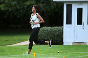 Michelle Obama pulled off this print blouse and sequined canvas sneakers combo while working out at the White House.