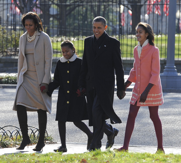 Michelle Obama Layered Pearl Necklace [best pictures of the day,standing,outerwear,girl,uniform,walking,suit,official,barack obama,michelle obama,rick perry,daughters,sasha obama,services,afp out,uk,u.s.]