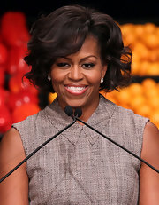 Michelle Obama looked sassy with this short curly 'do during a Walmart event.