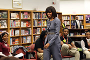 Michelle Obama wore a business-like yet stylish gray pantsuit during her visit to Harper High School in Chicago.