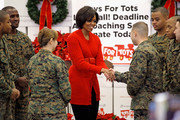 First lady Michelle Obama thanks U.S. Marine Corps Reserve members after sorting toys for the Toys For Tots program at Joint Base Anacostia-Bolling December 17, 2010 in Washington, DC. With nine days until Christmas, Obama joined about a dozen marines in sorting some of the 100,000 toys that have been donated to children in need in the Washington, DC, area.