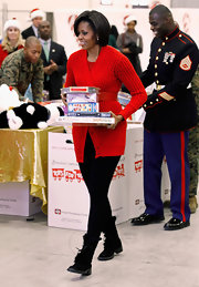 Michelle Obama looked all set for winter in her fur-lined lace-up boots during a visit to a Toy for Tots distribution center.