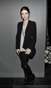 Michelle Trachtenberg layered a black open front Becky blazer over a whimsical heart print top.