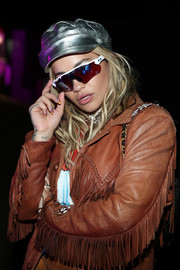 Rita Ora arrived for the Midnight Garden After Dark party wearing a pair of athletic shield sunglasses by Oakley.