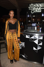 Jourdan Dunn hit the Midnight Garden After Dark party wearing a pajama-style mustard pantsuit.