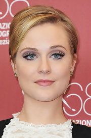 Evan Rachel Wood paired her black and white ensemble with simple champagne and white diamond stud earrings.