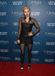 Miley Cyrus rocked a little black leather dress with a sheer yoke and sleeves while attending an Omnia Nightclub event.